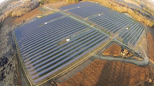 What are some benefits of a centralized approach in small utility solar projects?